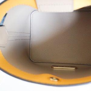 746cc1312f6e Michael Kors Bags - Michael Kors Kimberly Leather Bucket Bag Marigold